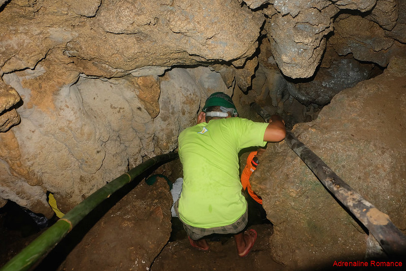 Tight squeeze to the underground stream in Maanghit Cave