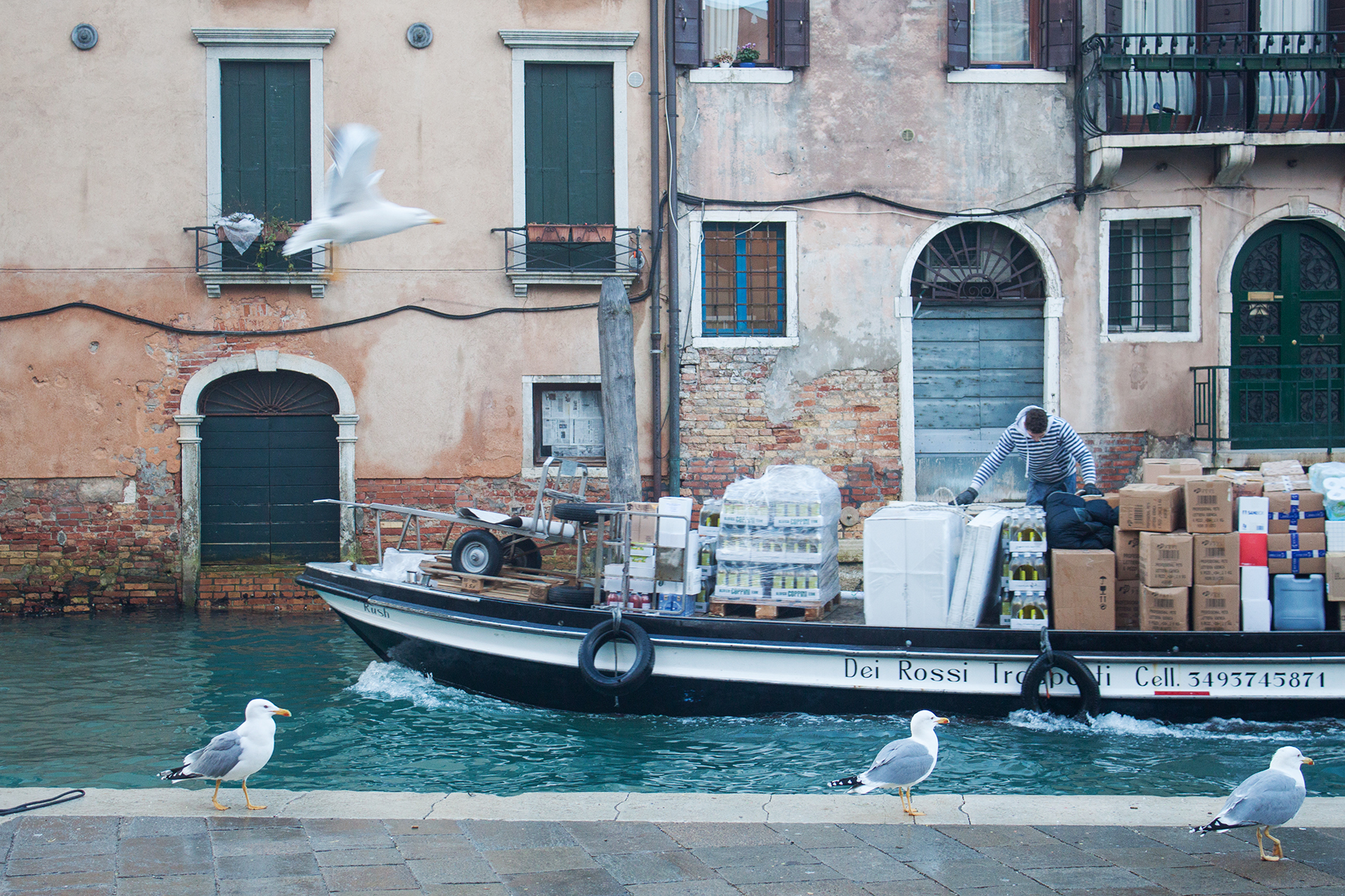 Streets of Venice, Man on Boat | awaywithkatie.com