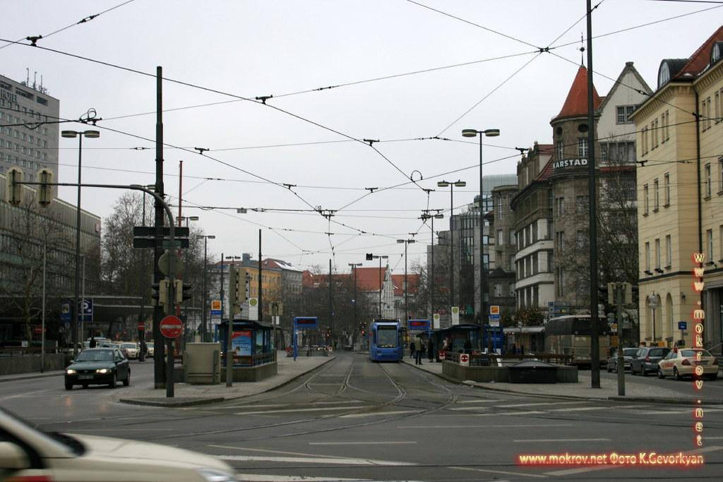 Мюнхен — город на реке Изар на юге Германии и фотограф