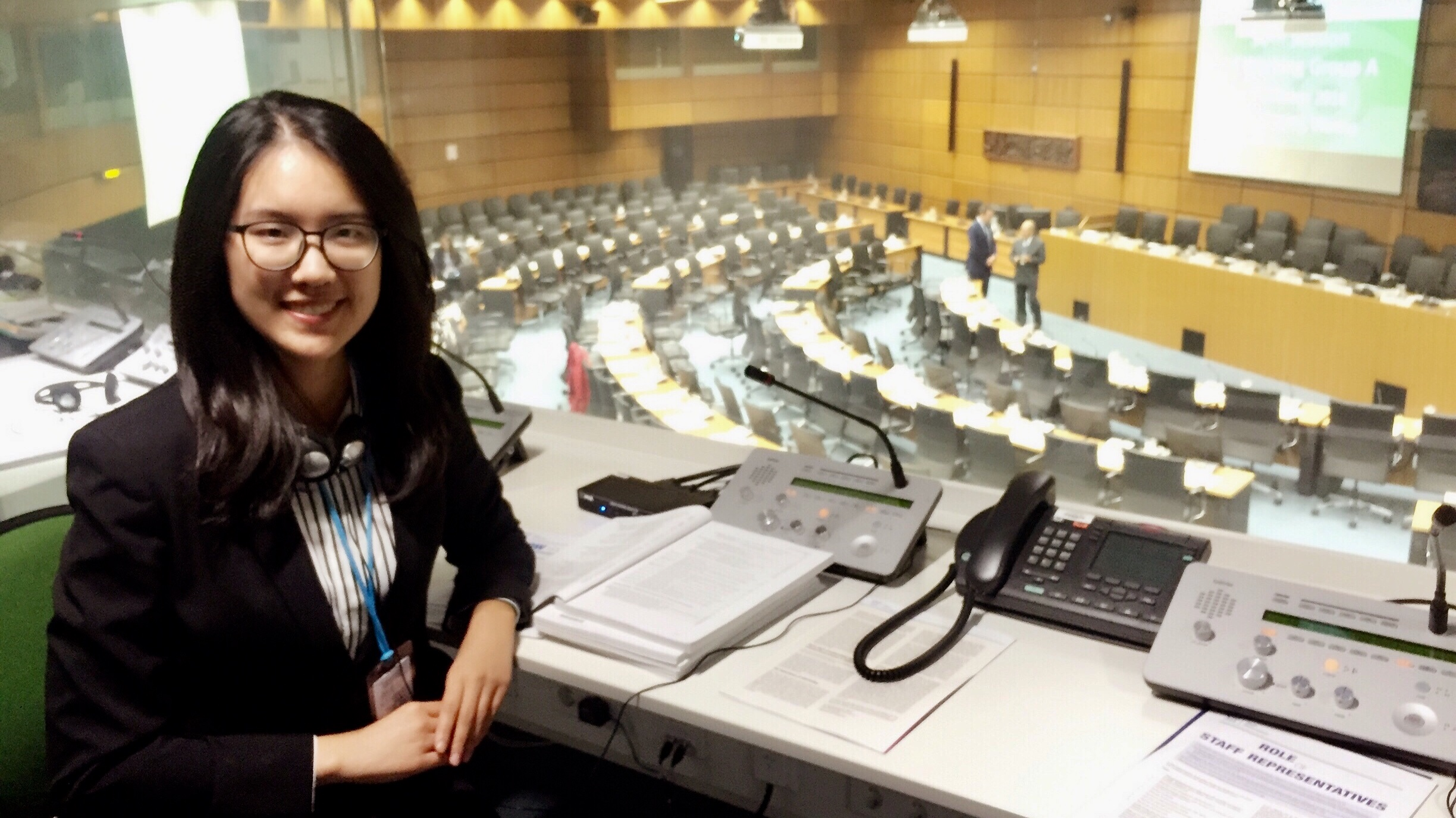 Chuqin Qi in a translation booth at the United Nations.