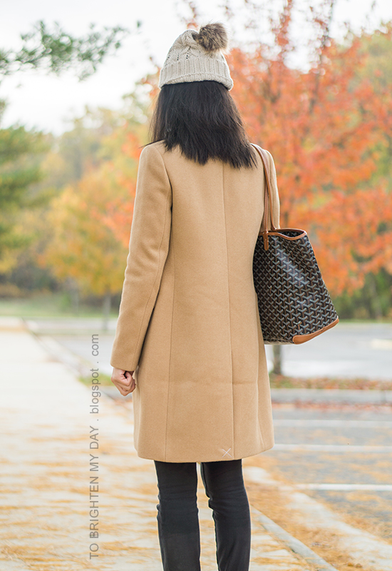 beanie with pom, camel long coat, black skinny jeans