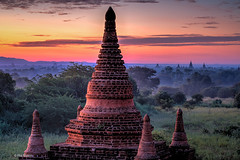 Sunset over the thousands of Buddhist temple stupas in the Plains of Bagan, Myanmar