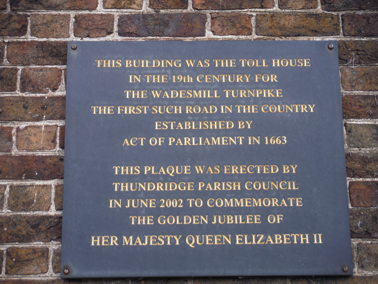 Plaque on Turnpike Tollhouse, Wadesmill SWC Walk 165 - St. Margarets Circular