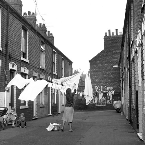 Washing woman and kids in Derwent Avenue, Westbourne Street (27 March 1978) by Alec Gill