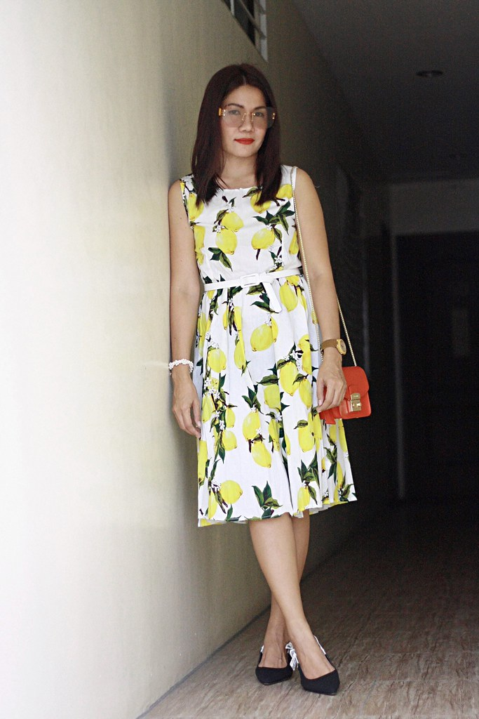 c82e14a5564 This sleeveless lemon print dress comes in three colors. It s too cute and  lovely