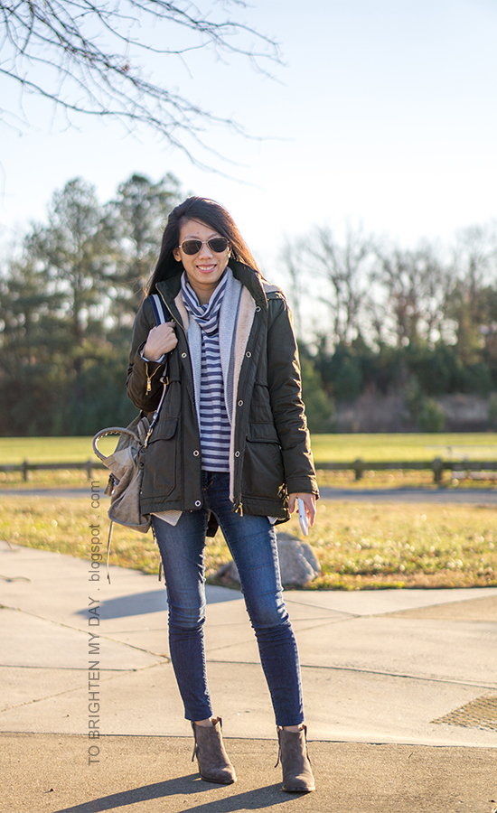 olive green parka, gray open cardigan sweater, blue striped fleece turtleneck, skinny jeans, gray tote with striped strap, gray suede ankle boots