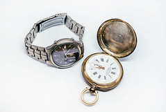 Old Pocket Watch And Titan watch isolated on the white background