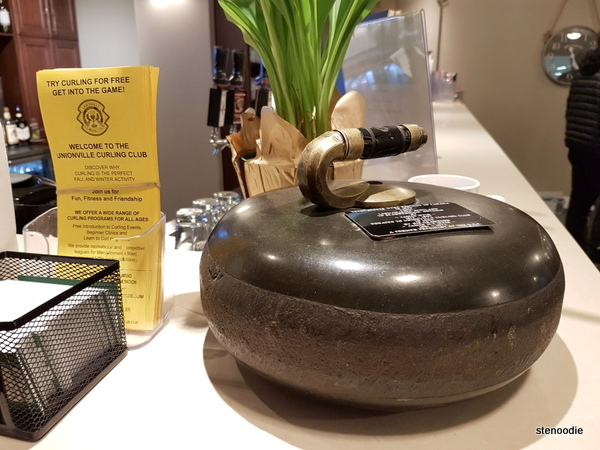 curling stone on display