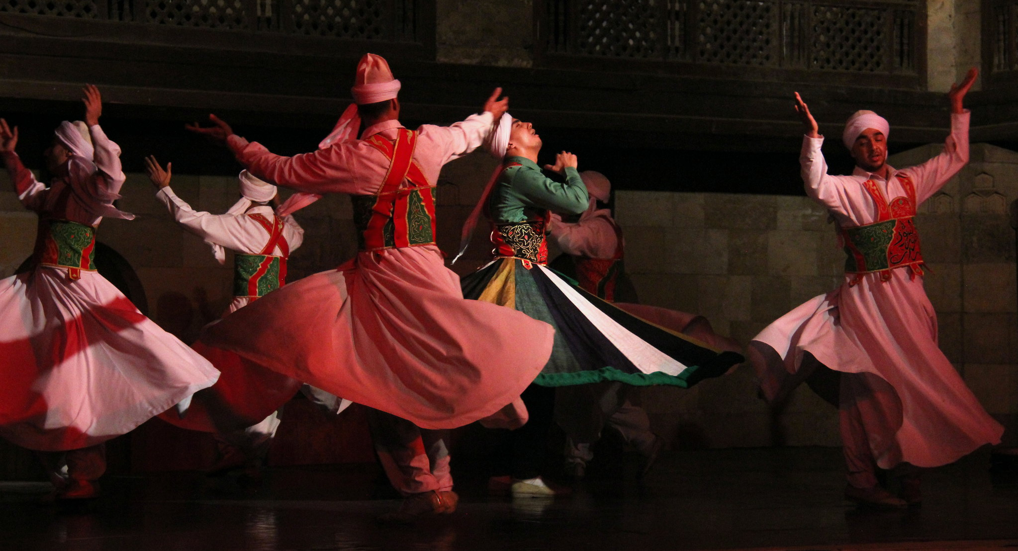 Tanoura dancers whirl in circles