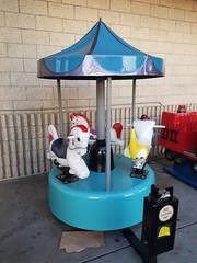 Mini carousel kiddie ride (Blue gray and teal; Ponies, donkies and elephants)