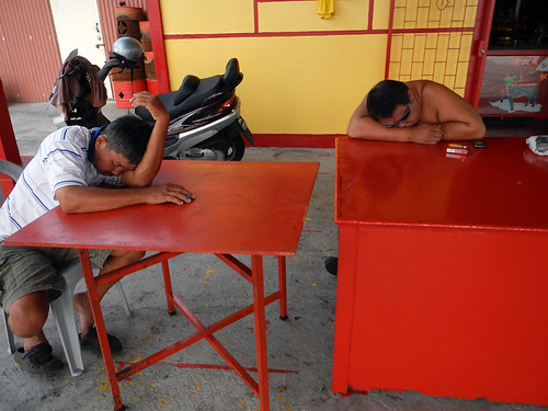 Sleeping men in the village on the Penang Jetty (Malaysia)