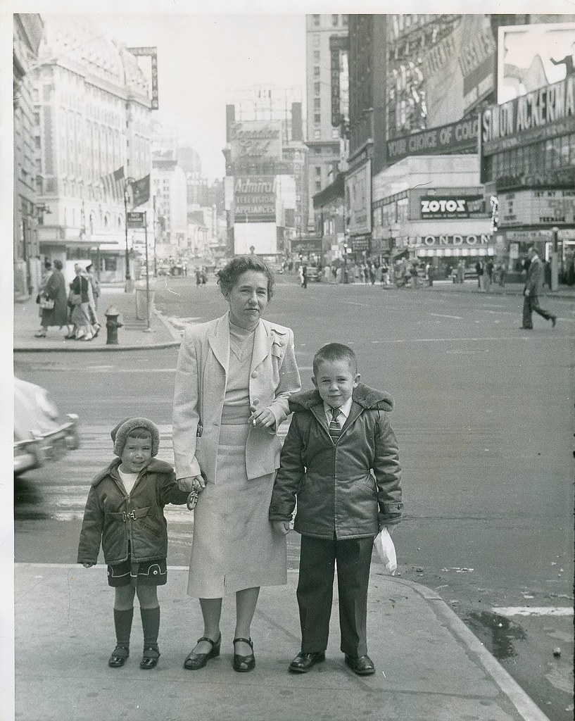 Woman and her children pose in Times Square N.Y.