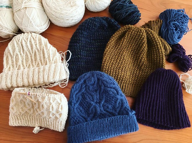 It's so flipping cold out. I'm just going to stay under blankets, netflix and knit. The hat pile grows. #netflixandknit #knitting #hatknitting