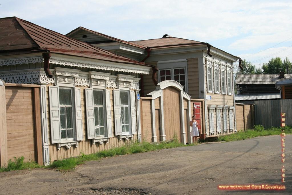 Город Иркутск с фотокамерой прогулки туристов,