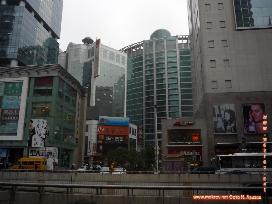 Город Шанхай фотографии сделанные как днем, так и вечером