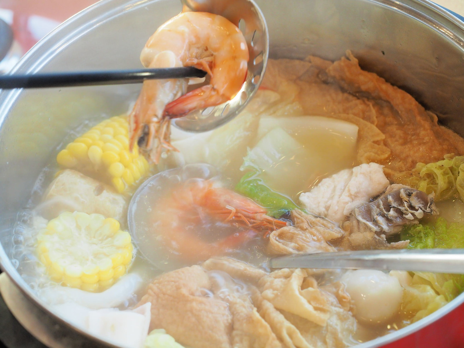 Taking the prawn out from the steamboat