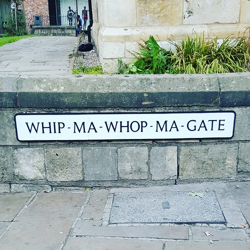 The street sign for Whip-Ma-Whop-Ma-Gate, an integral part of York folklore