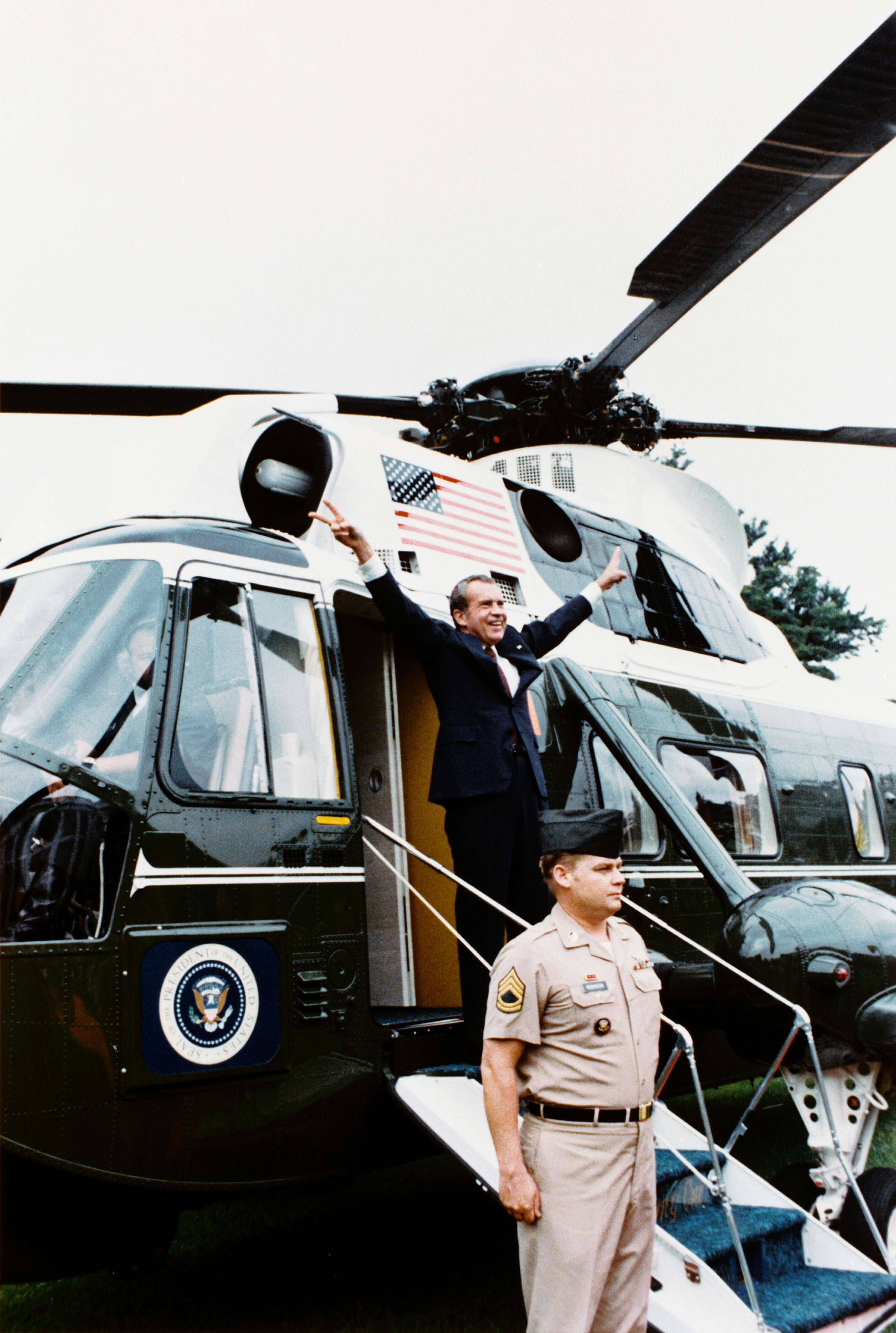 Richard Nixon boarding Army One upon his departure from the White House after resigning the office of President of the United States following the Watergate Scandal on August 9, 1974.