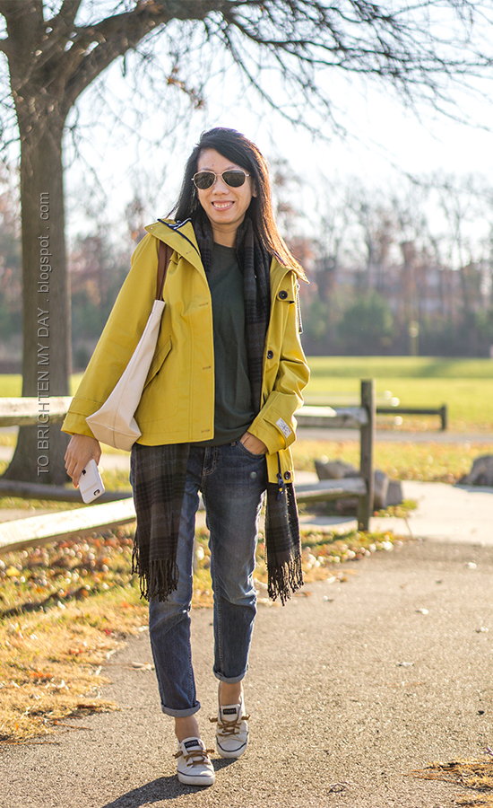 yellow rain jacket, olive green side tie top, green plaid scarf, canvas tote, girlfriend jeans, canvas sneakers