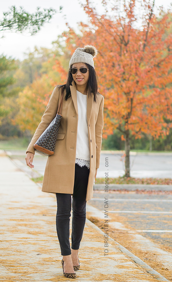 beanie with pom, camel long coat, white sweater with lace hem, monogrammed tote, black skinny jeans, leopard pumps
