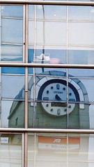 Japan Travel Bureau JTB Corpoartion 株式会社ジェイティービー Citizen シチズン Clock 時計 refelcted in Ueno, Tokyo, Japan.