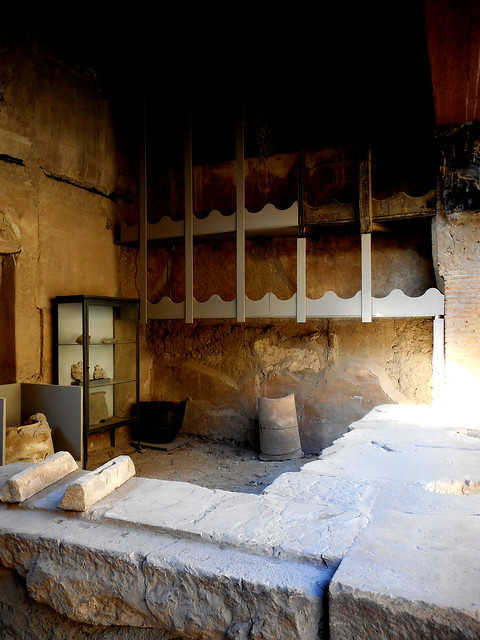 Shop of the welder, with carbonized wooden corbel at Herculaneum, buried by Vesuvius' eruption on 79 AD