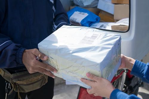 Postman deliver for goods of online shopping