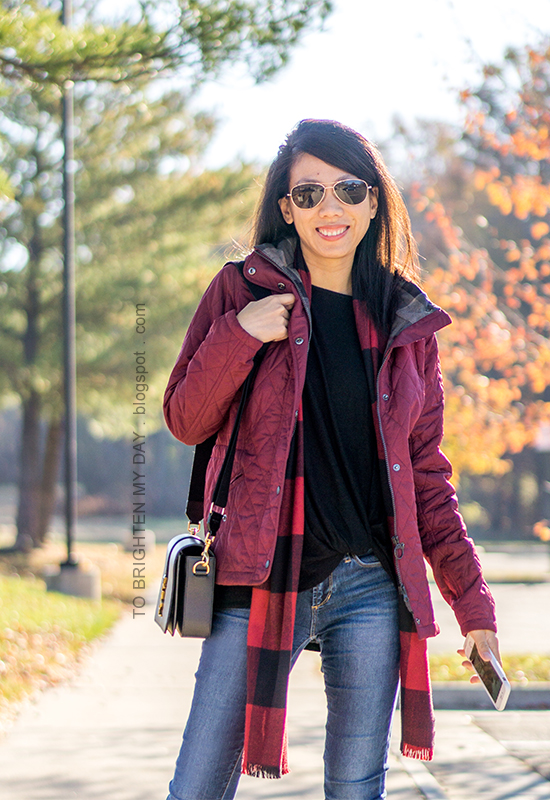 red quilted jacket, black twisted hem top, red buffalo check scarf, black shoulder bag, skinny jeans