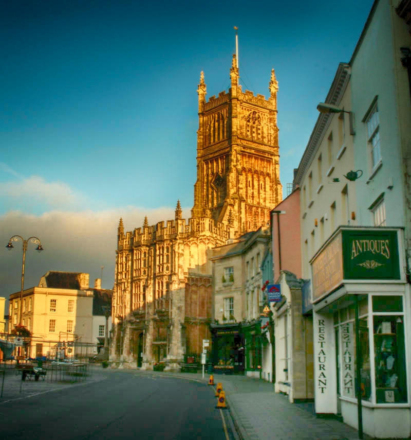 Street in Cirencester with St John the Baptist parish church. Credit SLR Jester