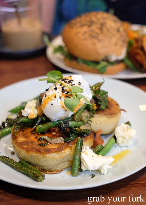 Sourdough crumpets with green beans and poached egg at Two Chaps vegetarian cafe in Marrickville
