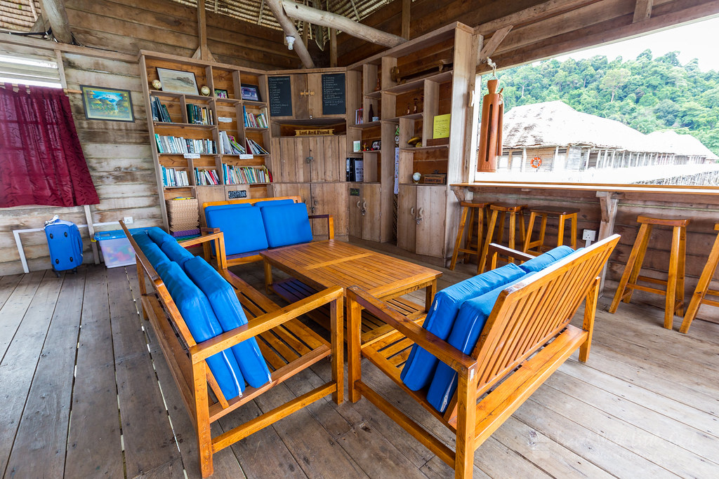 "Sofa at the common area, dining hall with the ""Gong"" at the window, Telunas"