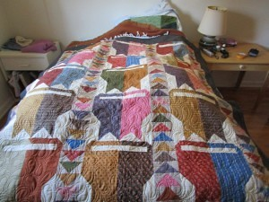 Cats and flying geese quilt