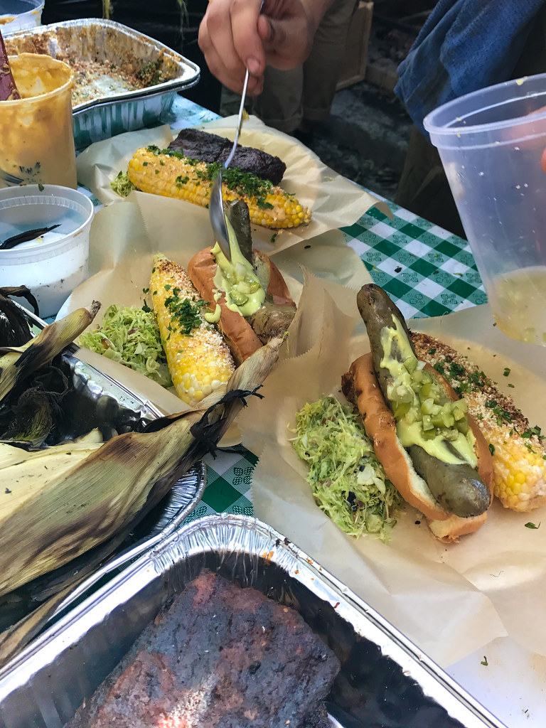 Sausage, mortia chile-glazed ribs, elote and broccoli, avocado, apple slaw