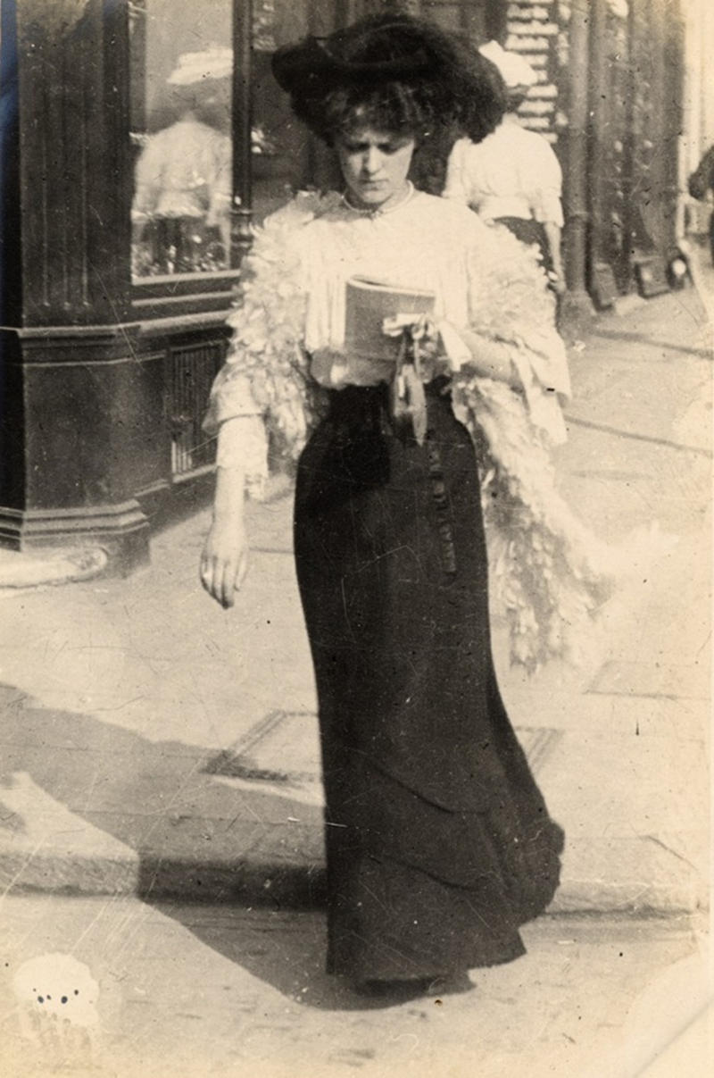This woman is a shop salesperson, walking along Kensington Church Street, on September 8, 1906