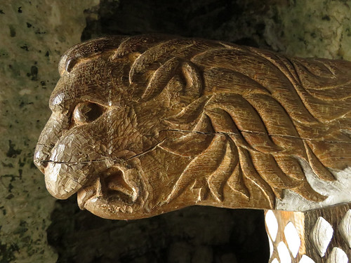 Carved lion on the arm of a chair in Kidwelly Castle in Wales