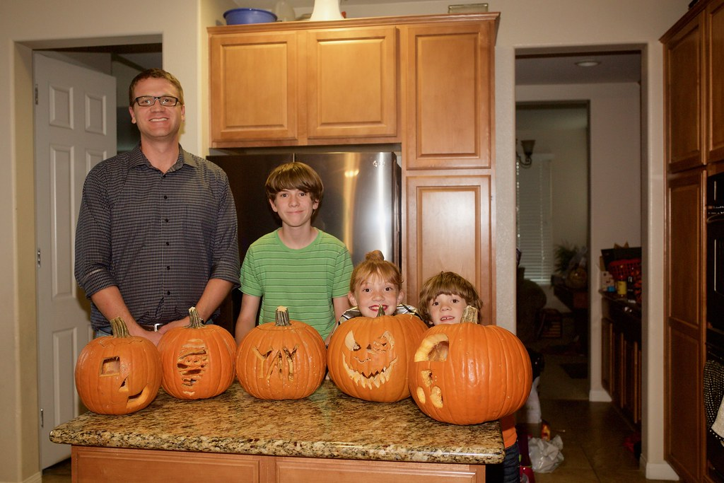 dad and kids and pumpkins