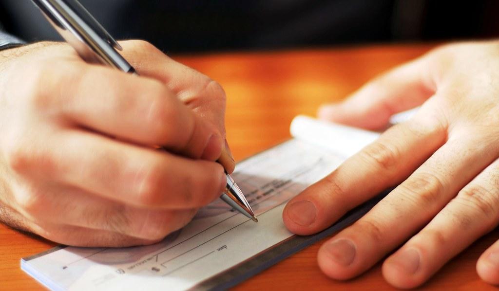 Cheques serão compensados em até um dia útil, decide Banco Central, cheque
