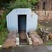 TIMS Mill Tour 2017 UK - Leeds - Thwaite Putty Mills - Garden with air raid shelter-9807