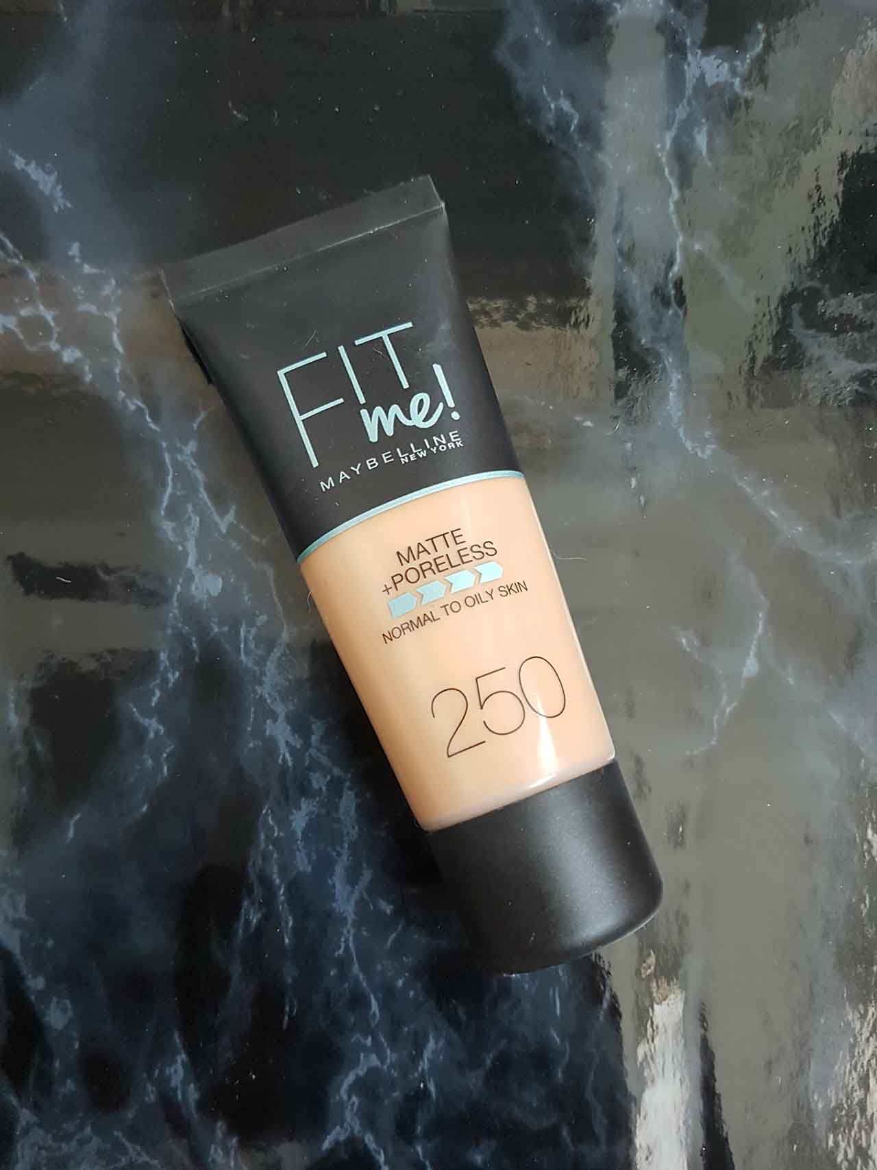 Summer's Gone But Not Forgotten - My Summer Bronze Haul: Maybelline Fit Me Foundation - This foundation is much better than I was expecting it to be! I had heard lots of views on the results so I thought the only way to know for sure is to test it myself! It is designed to be a matte poreless coverage and suitable for normal to oily skin. I have used it a few times now and it always gives me a smooth and flawless look without looking caked on or unnatural. The consistency is reasonably thick, almost paste like but it glides onto the skin well and melts into it. For a high street branded foundation, it's very good and worth trying!