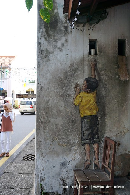 Boy Reaching Up Penang Street Art