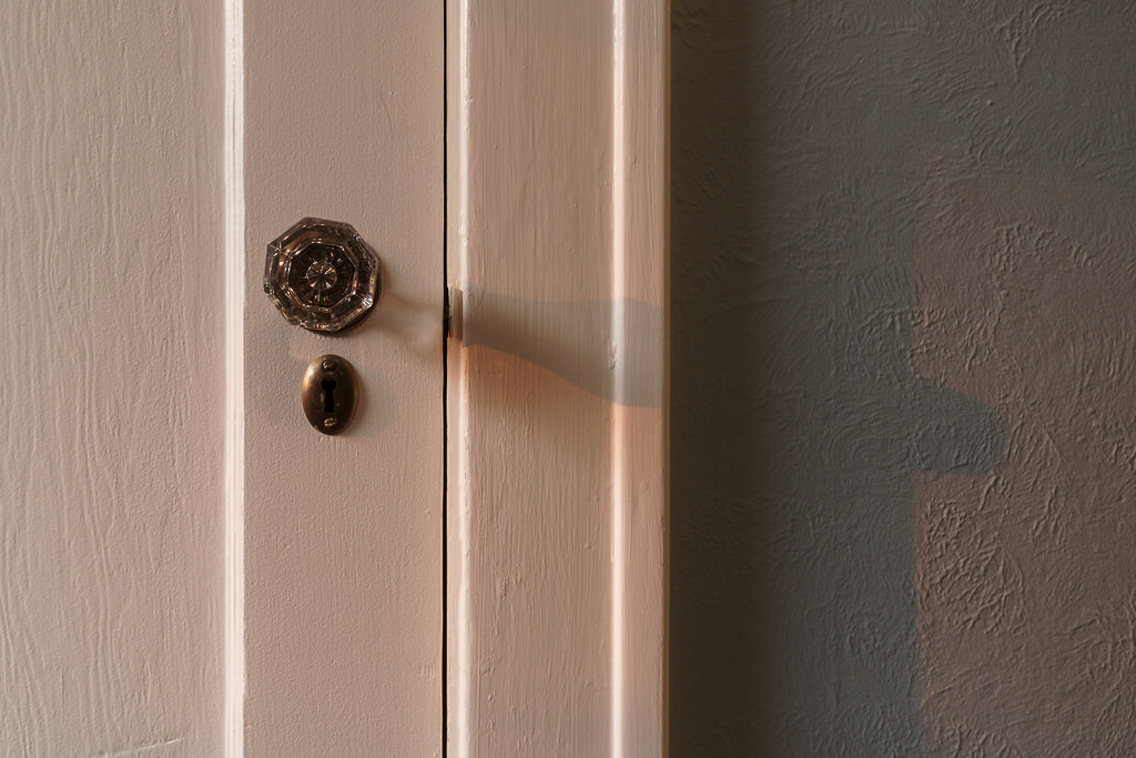 The doorknob to my closet lit by a reddish sun