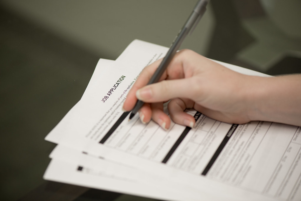 Woman Filling Out Job Application