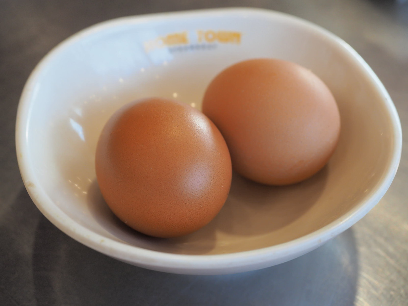 Two chicken eggs for the Classic Seafood Set