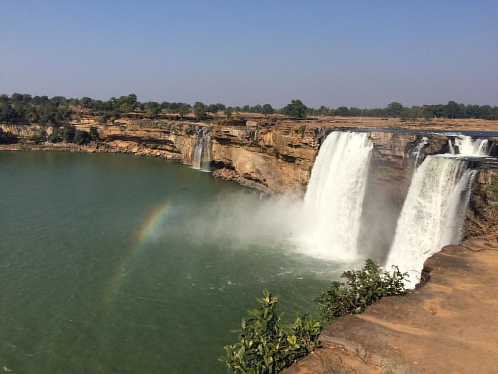 This is the magnificent #chitrakootfalls. It is magnificent. Returned to this place after a decade or so, was beautiful. Can you make out the #rainbow formed by sun rays falling on the dispersed water particles (#prismaticeffect ) been so long since I use