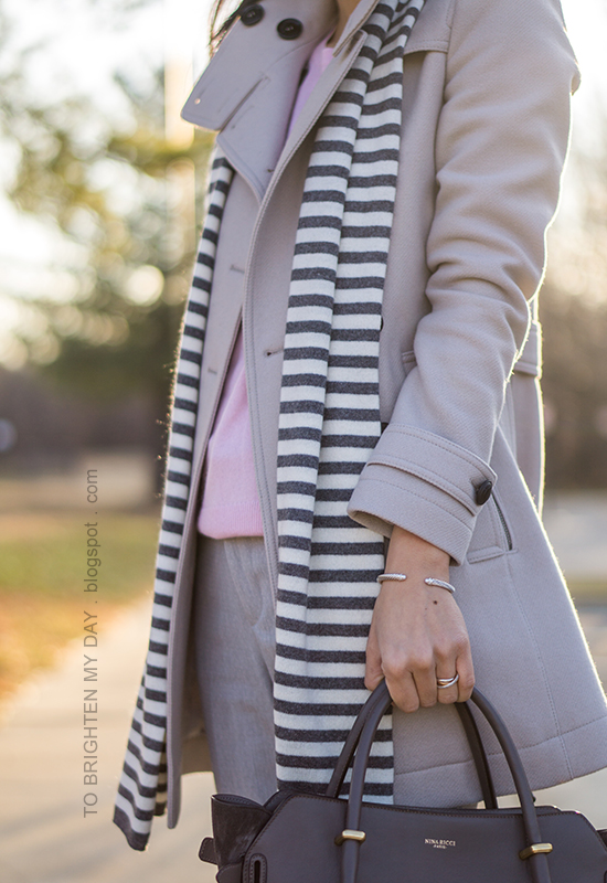 striped scarf, gray wool trench coat, pink cashmere sweater, cable bracelet, infinity rings, gray pants, gray tote