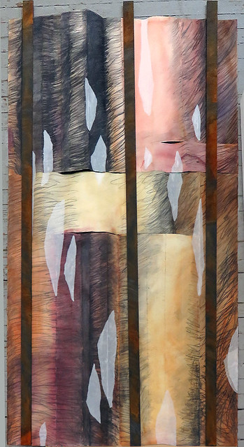 A large 4' x 8' 2-sided hanging of some basalt rock formations - this is the watercolour & pencil scribble side.