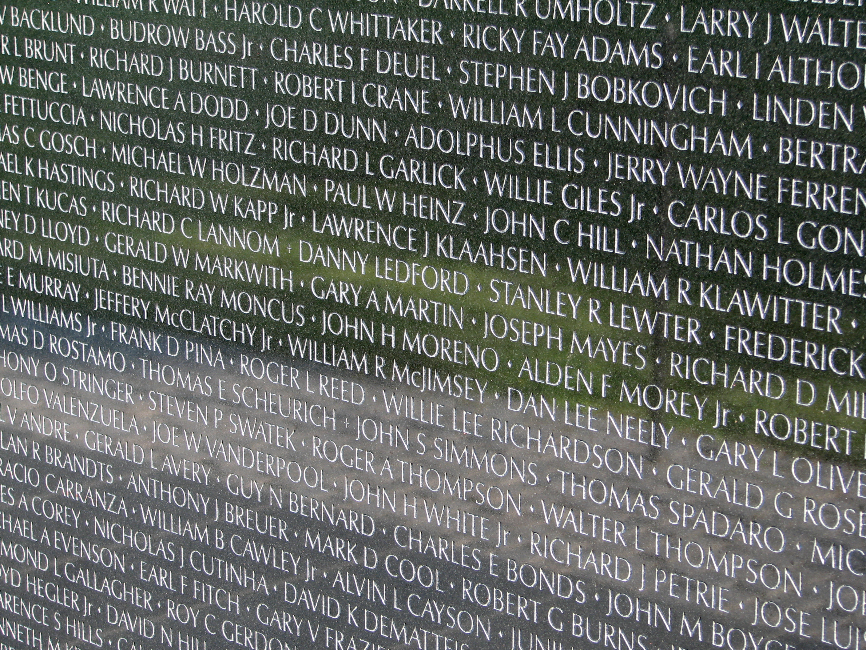 Names of Vietnam veterans at Vietnam Veterans Memorial in Washington, D.C. Photograph taken by Hu Totya on September 18, 2006.