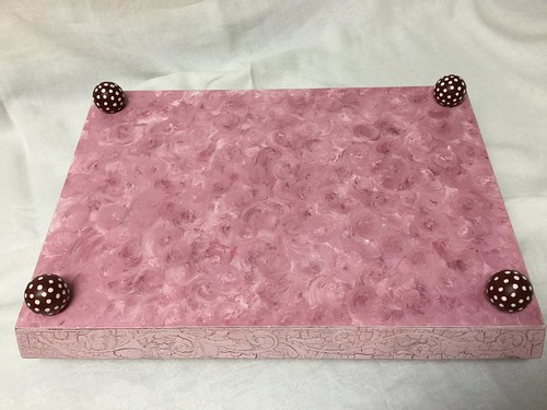 Pink bottom of tea tray.