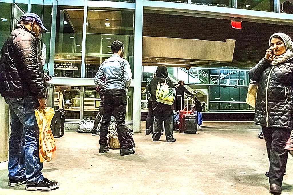 JFK passengers waiting at Howard Beach Station--Queens