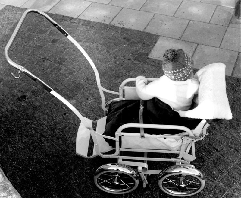 A toddler in a lightweight sports pram, 1959